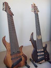 9 string fanned fret conklin custom 9 string pac man bass custom knobs and inlays