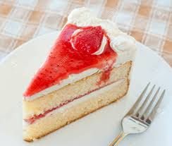 piece of cake with cream and jelly strawberries stock photo