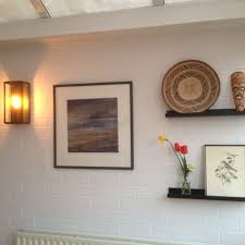 painted brick wall in conservatory painted using wevet colour