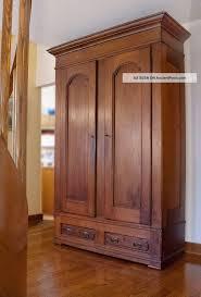 clothing armoires antique walnut knock down armoire 1900 1950 photo house ideas