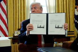 trump in oval office trump signs tax cut into law at rush job oval office event the