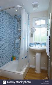 Blue And White Bathroom Tile Blue Mosaic Wall Tiles Above Bath With White Shower Curtain In