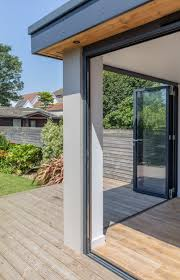 Patio Bi Folding Doors modern rear flat roof extension large sliding aluminium doors
