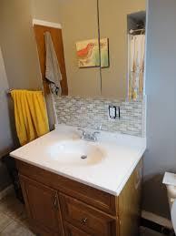 bathroom awesome mirrored tile backsplash with towel railing and