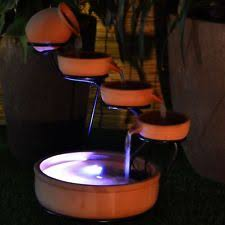water fountain with lights easter island head solar water fountain and planter with led lights