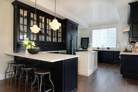 black kitchen cabinets with white countertop kitchen tray ceiling transitional kitchen jillian harris