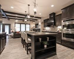 what color wood floors go with espresso cabinets kitchen with stainless steel appliances wood kitchen
