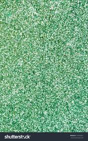 green glitter texture background party invitation stock photo