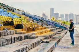 street art news by wynwood murals the miami marine stadium captures our attention with the return of artist douglas hoekzema aka hoxxoh as he reclaims his territory by creating a new