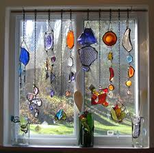 stained glass ornaments draped in a window pinteres