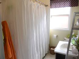 dark shower curtain with polka dots motive in small bathroom
