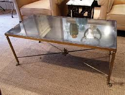 a brass and mirror coffee table in furniture