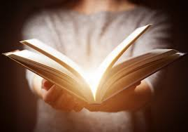 lighting inc new orleans louisiana light coming from book in woman s hands in gesture of giving best