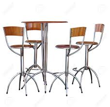 four tall bar stools at a table stock photo picture and royalty