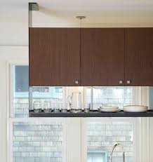 putting up kitchen cabinets creative ways to use hanging storage in your kitchen hanging
