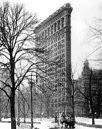 flatiron building with horse and carriage in the snow 1910 nyc