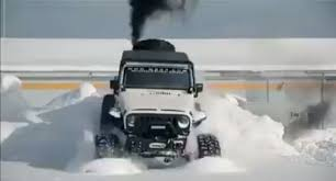diesel jeep rollin coal no obstacle for the snow king called jeep wrangler cummins