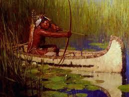 native american brave hunter in his canoe armed with bow and native american brave hunter in his canoe armed with bow and arrow