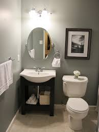 bathroom vanity cabinet wall mounted sink mirror plant full size dual flush elongated bowl toilet oval bathroom mirror gray stained wall three holes