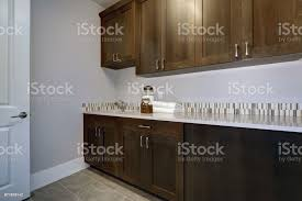 blue kitchen walls with brown cabinets laundry room interior features blue and grey walls stock photo image now