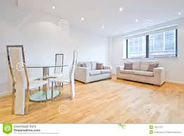 modern living room with two sofas and dining area stock image