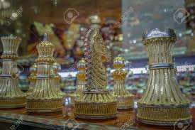 a luxury chess set of a knight rook bishop and queen encusted