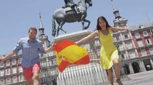 Spainish Flag Spanish Flag People Cheering Celebrating Showing Spain Flag In