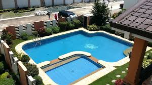 Pool In The Backyard by Swimming Pool Large Lap Pool With Nice Wheel Lounge Chair At The