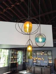 lighting stores in asheville nc hubbardton forge l with blown art glass l shade in red