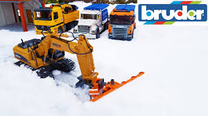 bruder excavator bruder toys snow in the bruder world excavator with plow youtube