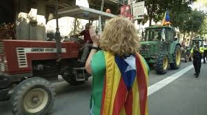 catalan farmers drive hundreds of tractors through barcelona in