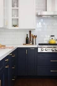 two tone kitchen cabinets with black countertops 25 trendy contrasting countertops for your kitchen digsdigs