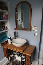 singer sewing machine converted to bathroom vanity this old