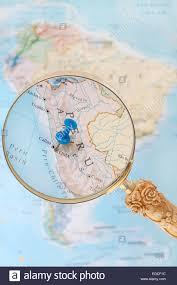 lima map blue tack on map of south america with magnifying glass looking in