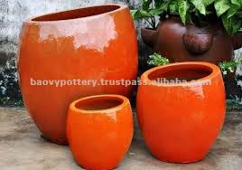 round glazed ceramic planter in orange set of 3 buy new design