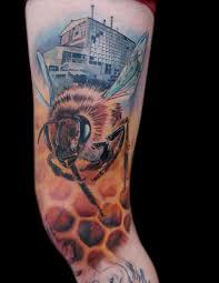 illuminati tattoo by nate beavers tattoonow