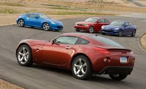 mazda car and driver nissan 370z vs bmw 135i mazda rx 8 r3 and pontiac solstice gxp