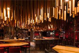 2 700 wood lengths hang from the ceiling in this new montreal