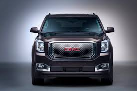 gmc yukon red all new gmc yukon has been manly suv gains more refinement