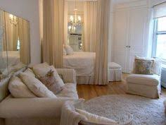 Privacy Please Ideas For Carving Out A Cozy Bedroom In A Studio - Small studio apartment designs