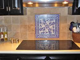 photo of blue and white foral backsplash