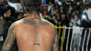 david beckham s tattoos where are they and what do they
