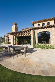 mediterranean house with natural stone paving milgard windows
