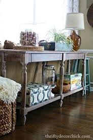 everett foyer table from world market used as a sofa table extra