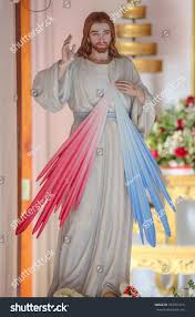 home interior jesus figurines divine mercy jesus statue stock photo 704761615 shutterstock