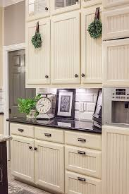white beadboard kitchen cabinets adding bead board and molding to my cabs like this beautiful
