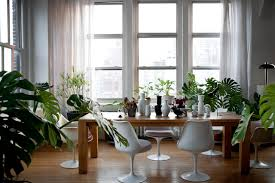 window table for plants fabulous industrial diningroom urban view features long table with