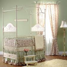 vintage nursery crib with iron platform frame also flower bedding