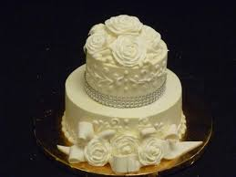 small elegant wedding cake with porcelain topper picture of las