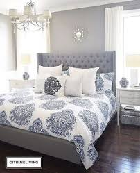 neutral master bedroom refresh white bedding neutral rug and